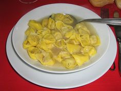 """Tortellini in Brodo-But for centuries right up to today, three main traditional dishes have been served on Venetian Christmas tables for the joy of all diners: Capeeti or Ravioli in Brodo di Cappone (Ravioli in Capon broth), Cappone lesso (boiled Capon) and  """"Musetto"""" (boiled salame) with Puree di patate (mashed potatoes) and spinaci (spinach)."""