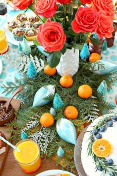 Natural Table Runner, Accented with Oranges and Bottle Brush Trees // Orange + Turquoise Holiday Brunch Tablescape