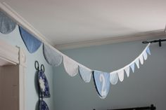 Scalloped Fabric Bunting with Applique Number or Letter (blue and white). $34.00, via Etsy.