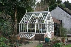 A Hidcote in white with 2 coldframes