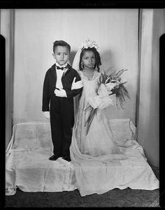"Little Bride & Groom   ""Tom Thumb wedding portrait, with bride holding bouquet with gladiolus and large striped ribbon, posed in Charles ""Teenie"" Harris Studio c. 1945-1950."" The little girl reminds me of my mom as a kid."