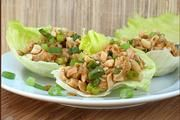 Thai Chicken Lettuce Wraps. I make a variation of the this recipe by omitting the mushrooms, add chopped onions and serve with cooked Top Ramen Noodles. Go easy on the peanut butter.