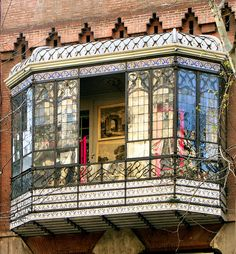 Barcelona - Rosselló - put a balcony out the side over the garden, tile the bottom and top, iron windows....not that hard to accomplish
