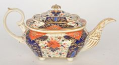 A 19th Century Derby teapot of silver form decorated in the Imari pattern with gilt detailing, painted marks alongside typed paper label stating (by repute) From the estate of the Most Rev'd Richard Downey dec'd, late Archbishop of Liverpool (R.C)