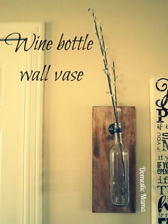 Wine bottle wall vase idea. This would be beautiful with some wildflowers. I may try to make it with mason jars so I can have more options regarding what to put in it.