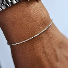 Apart from my earrings, I much prefer simple and delicate jewellery like this silver bracelet.