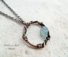 copper barbed wire circle pendant with apatite rough gemstone by Pillar of Salt Studio #wirejewelry