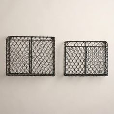 One of my favorite discoveries at WorldMarket.com: Ryan Wire Baskets.  would make a cute wall-mount mail center