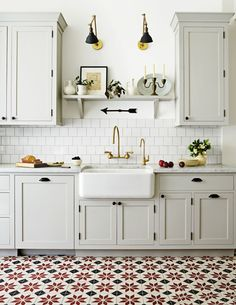 Old World Kitchen With Patterned Floors, Off White Cabinets And Light Gray  Cabinets.