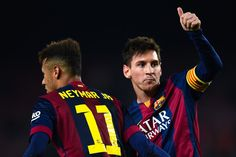 Lionel Messi of FC Barcelona celebrates with his teamm-ate Neymar of FC Barcelona after scoring his team's third goal during the Copa del Rey Round of 16 First Leg match between FC Barcelona and Elche CF at Camp Nou on January 8, 2015 in Barcelona, Catalonia.