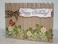 I love this simple Happy Birthday Fence idea. The daisies are perfect. The Fence is the focus.
