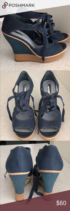 Lace Up Navy Wedges Cute navy blue wedges that lace up. Perfect for Spring, Summer and Fall. Worn only once. Like new. Seem to run a tad small as I wear a 9 and these are a 9.5. Halogen Shoes Wedges