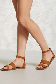 eb70e1435 A pair of faux suede sandals featuring a strappy front