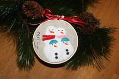 Ornament Sent for Trim the Tree Ornament Swap by Modernsewl, via Flickr - love this - where to find mini embroidery hoops that are wood?