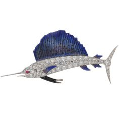Diamond-set enamel sailfish brooch, with ruby eye, set in platinum and 18k gold,by Cartier circa 1930.