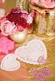paper doily hearts and pink and red flowers...Loving these homemade vases from old pickle jars