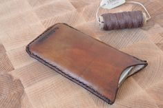 An antique rustic leather cell phone sleeve