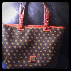 Authentic Dooney and Bourke Great condition.carried for a month.no stain or rips.No damage at all.great for everyday bag.10 inch tall and 16 inch wide.make a reasonable offer. Dooney & Bourke Bags Shoulder Bags