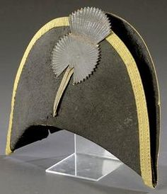 "A beaver skin Militia Officer's Chapeau De Bras, circa 1800 to 1820. Felt hat with gold bullion border. Sides of hat tied to crown with thin-ribboned thread. Black leather fan cockade with raised American eagle and a 4"" gold bullion strand connecting to area of hat void of a brass button. Interior of hat presents partial brown patent leather sweatband and complete brown glazed cotton liner."