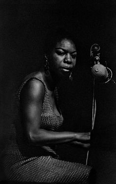 """Nina Simone Photographer: Francine Winham Location: Newport Date: 1965 """"Nina was a fiery personality, uncompromising supporter of women's and civil rights. Often she would walk off stage if something upset her and returned!"""" Francine Winham"""