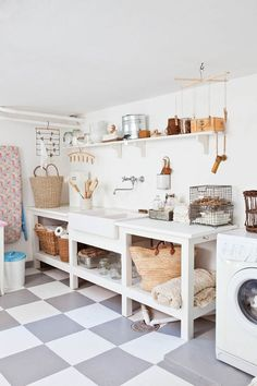 This is a laundry room, but would love the look for a kitchen. Open shelves with baskets ♥