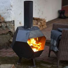 This steel chiminea& sharp geometric shape makes it stand out, adding a rustic and rugged feel to your backyard.