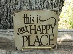 This is our Happy Place .  8x8 ceramic tile with brown premium vinyl lettering and gold stand. on Etsy, $16.00