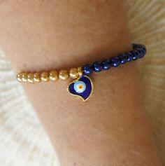 Evil eye bracelet with metallic navy and gold colored beads. The original size is 7.1 (18cm), can be any size.  Evil eye beads go back thousands of