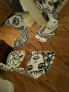 i asked the crazy talented justin teodoro to paint my boring white dining chairs. this is what he did.
