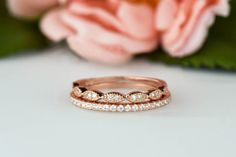 The is a beautiful reproduction antique pave wedding set. This delicate design is the perfect edition to a rose vintage engagement or everyday ring stack.  ◆ Band Weight: .87 Grams ◆ Approximate Band Width: 1.5mm ◆ Model Ring Size: 5   Ring Size: If your size is not available, we may be able to custom size it for you. Please contact us for more information and pricing. ❏ What are your stones?  We use the finest diamond simulant available on the market, especially made for our products. Our…