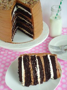 Six-Layer Chocolate Cake with Toasted Marshmallow Filling and Malted Chocolate Frosting - Blahnik Baker