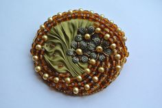Bead Embroidery Brooch, with shibori silk , glass beads, seed beads and bronze tone detail. bronze flower