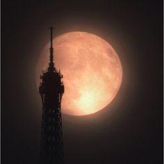 Super moon rising behind the Eiffel Tower.