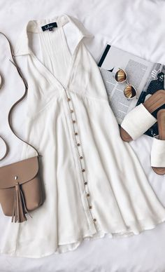 White button down dress, tan cross body bag, white slip on sandals, sunglasses.