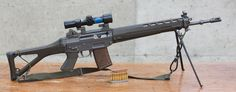 Sig 550 rifle with bipod and 4x scope