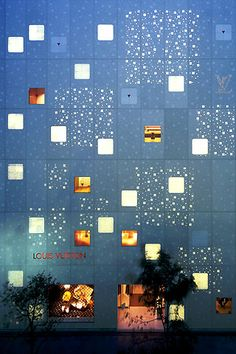Louis Vuitton Store, Tokyo, 2004 - Aoki Jun.  White translucent Indian alabaster is cast into glass reinforced concrete that creates a varying amount of translucency.  Some parts of the panel are as thin as 15mm.