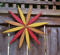 For your outdoor and indoor decorating this year consider my colorful wooden folk art style starburst wreath made from reclaimed pine. Options for placement are limitless!  The warm tones and friendly design will be a subtle and refreshing rustic decoration to enjoy throughout the year. Add color to an outdoor wall or lighten up your garden during the winter. Many people like to place their starburst art indoors as well to brighten a wall.  Laughing Creek colors included in this starburst…