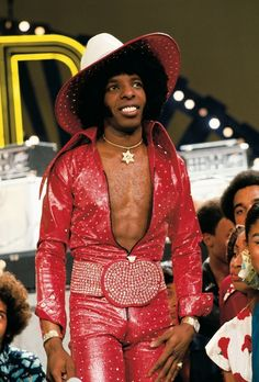 Sly Stone on Soul Train! It astounds me that people put clothes like this on.
