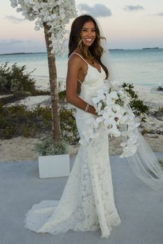 Our beautiful bride wearing the Katie May Poipu Gown.