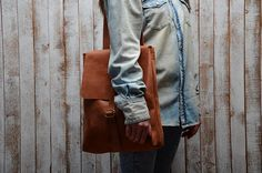 Backpack -Transformer It can be worn on the shoulder like a shoulder bag Unisex Leather backpack ,Laptop backpack Genuine leather One inside open pocket Adjustable shoulder straps  Backpack -Transformer  Fits any13 laptop  Measurements: SIZE: 34 x 28 x 8 cm  We make leather products with the finest leather at the highest standard. Our collection represents many months of research and product testing. We are confident that our products will last several decades or even your whole life.  We…