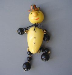 Shultz Bakelite cream dangly man brooch.
