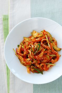 Ojingeo muchim is a spicy, sweet and tangy dish that's made with boiled squid and fresh vegetables. It's a refreshing dish that will increase your appetite. Squid Recipes, Spicy Recipes, Asian Recipes, Cooking Recipes, Ethnic Recipes, Hawaiian Recipes, Seafood Recipes, Yummy Recipes, Korean Cucumber
