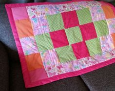 Fun for a little girl or anyone who likes pink. Throw or lap blanket Materials: Cotton fabric thread Anti-pill backing Quilt-Light Batting 100% Polyester