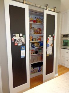 Trying to squeeze a small pantry into a kitchen? Save some space and create a really cool element by using a sliding barn door to hide the pantry, or the laundr Paint For Kitchen Walls, Kitchen Doors, Kitchen Pantry, Kitchen Rustic, Kitchen Small, Pantry Cabinets, Cupboard Doors, Buy Kitchen, Barn Door Pantry