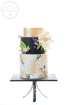 A truly sophisticated cake for a 60th birthday. Based on an original design by Charm City Cakes.