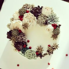 buttercream flowers and succulents with chocolate pinecones
