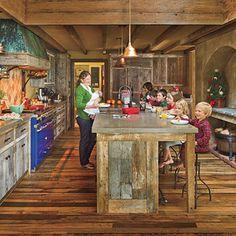 i love this kitchen for the layout... especially the raised fireplace behind the bar stools
