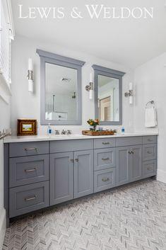 A classic coastal style blue vanity. Double vanity painted  Gull Wing Grey by Benjamin Moore #paintcolor #BenjaminMoore #bathroomvanity #doublevanity #coastalbathroom
