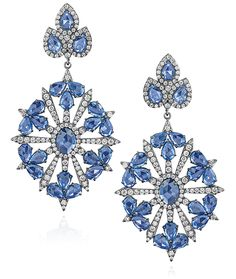 Cellini Jewelers Sapphire and Diamond Drop Earring  Edwardian-inspired pendant drop earrings, with center starburst diamond motif surrounded by pear-shaped blue sapphires; set in 18-karat black gold.