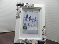 Photo frame seashells and seaglass by AngelsNEverlastings on Etsy.